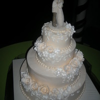 My First Wedding Cake Ivory Buttercream, Ivory Gumpaste Roses, White BC details and white gumpaste apple blossoms 16, 12, 8, 6