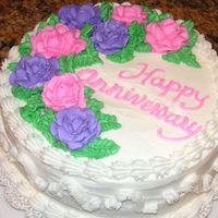 Gluten Free Anniversary Gluten Free chocolate cake with raspberry filling, whipped cream icing, buttercream decorations