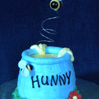 Pooh's Hunny Pot Smash Cake This was a smash cake that matched a first birthday cake done for a friend's son. Pot was iced in buttercream, bees were fondant and...