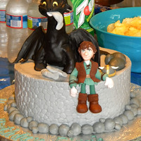 How To Train Your Dragon - Elijah Style This was my son's 6th birthday cake. Had cupcakes with little Viking hats to match the cake.