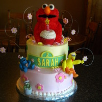 Elmo First birthday cake for a friend's daughter. All buttercream cake with fondant accents and sugarpaste figures.
