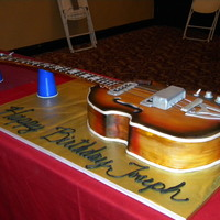 Joseph's Guitar Birthday cake for a 13 year old. Replica of Paul McCartney's Beatle Bass.