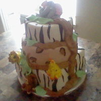 Jungle Friends chocolate, coconut and vanilla cake flavor with buttercream filling and marshmallow fondant all edible.