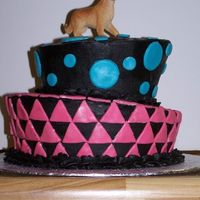 2Nd Cake Attempt This was for my niece's 8th birthday. She just got a dog, and therefore wanted a dog on top - he looks so out of place! The...