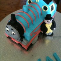 Thomas The Tank Engine I made this from the Debbie Brown books, for my first carved cake i think it turned out really well.