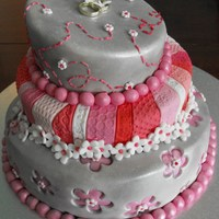 Pink And Silver Topsy Turvy Wedding Cake I made this for a friends wedding, it's a white chocolate mud cake. This is my first attempt at a topsy turvycake and i must say i...