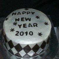 "Black And Silver New Years Cake 8"" white round cakes w/ buttercream icing airbrushed silver sheen. black fondant accents."