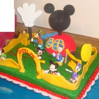 Mickey Mouse Clubhouse This cake was made for my niece who loves Mickey Mouse. I created the clubhouse by looking at a picture. I thought that the fence archway...