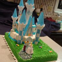 "Haley's Castle 13x19 cake with a 10"" circle cake then a 6"" square cake yellow cake with buttercream icing"