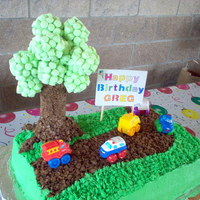 1St Birthday For A Car Fanatic This was for a friend's son. He loved cars and trucks. The icing is buttercream. The tree foliage is groupings of green mini...
