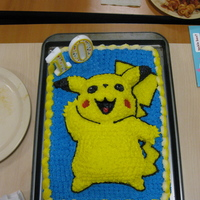 Pikachu Carved Cake The Pikachu was baked in a snowman pan and then carved into the proper shape and placed on a regular sheet cake.