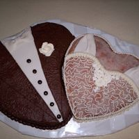 Double Heart Cake Her second wedding, his third. They didn't want a traditional cake. The groom's is chocolate and the bride's is lemon with a...