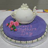 Mother's Day Teapot Cake I made this for a Mother's Day tea party at my preschool. The decorations on the teapot are MM fondant pressed into candy molds and...