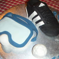 Football Boot, Scuba Mask, And Golf Ball Cakes! i made this for my boyfriends birthday. they are made of a ten layer cake of chocolate sponge and vanilla sponge and the detail/icing is...