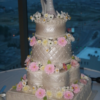 Multi Shaped Tier Embossed Formal Wedding Cake This is my first Wedding Cake with gum paste flowers and mmf. I made lemon curd and fresh raspberry sauce filling, alternating each tier....