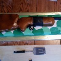 Rifle I hated this cake....from start to finish it was a nightmare. I made if for my best friends brohters birthday. He is a mans man who loves...