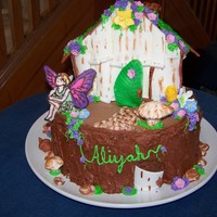 "Fairy House The house and ""stump"" are cake with BC. The decorations are a combination of fondant (the bark on the house, the door, the..."