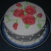 Mother's Day Cake  I did my mother a small cake for Mother's Day. I had just completed Wilton Course I and wanted to practice my roses. I don't...