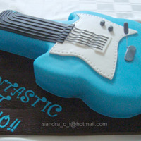 "Guitar Cake Guitar Cake, printed a guitar photo and used it as a template from an 11"" x 15"" sheet cake"