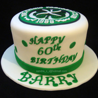 "Celtics Birthday Cake 8"" Chocolate cake with chocolate Bavarian filling. Logo cut by hand."