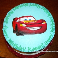 Lightning Mcqueen/soccer Cake! Fondant Lightning McQueen, painted with food coloring. Thanks for looking!