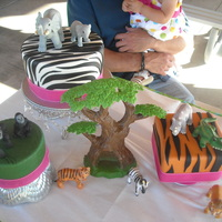 Jungle Theme! Not the best pic, but that's okay! Fondant with toy animals as decor. Thanks for looking!
