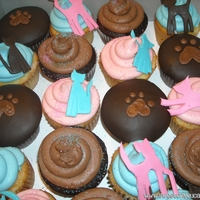 Kitty Cat Cupcakes Kitties are fondant, dark chocolate cupcakes are covered in fondant. And buttercream! Thanks for looking!
