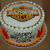 Harley Davidson Chocolate cake with BC and fondant accents. Thank you so much to CCer Grandmom for all of her help with the logo... it 's not perfect...