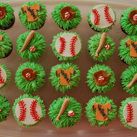 Softball Cupcakes   These were for a bake sale for the softball team. BC and fonant.