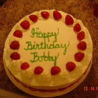 Bobby's Birthday Cake   Yellow genoise cake with strawberry flavored whipped cream icing with with fresh strawberries