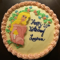 Sleeping Beauty Cake  This is two layer yellow butter cake with raspberry bc frosting filling and traditional vanilla bc on the outside of the cake. I piped...