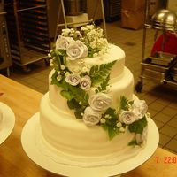 Wedding Cake   three tiered wedding cake with fondant roses with ivy and baby's breath accents