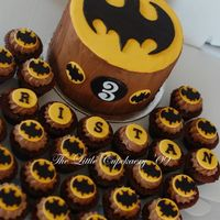 Batman Birthday Cake 'n' Cupcakes Created for my nephew. Batman symbol was cut-out individually using various shaped cutters...very time consuming.
