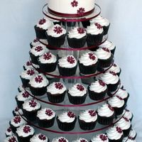 Aubergine Wedding Cupcake Tower Created for a horse themed wedding. Groom proposed at the races and so the reception is also at the races. I created bride and groom...