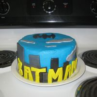 Batman Birthday Cake   Batman cake for my brother's 22nd birthday. Chocolate cake, BC frosting with MMF accents. Thank you CC members for the inspiration.