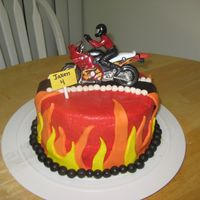 "Motorcycle Birthday  Motorcycle cake for my son's 4th birthday. BC frosting (used the viva paper towel method, first time). Flames, balls, ""road&quot..."