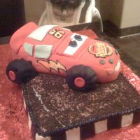 Lightning Mcqueen  This was two cakes put together. The bottom cake was just a sheet cake that I made to look like a dirt road and the car itself was a cake...
