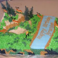 Dscf1957.jpg  This was a fun one, I used the plastic deer hunter cake topper. This cake was so heavy. I used 6 pounds of powdered sugar for the...