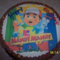 Handy Manny Cake Chocolate cake with chocolate icing. Printed Icing Lay-on.