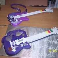 Hannah Montana Guitar Cake Fondant covered cake with fondant details.