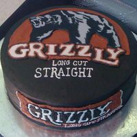 Can Of Snuff   Grizzly bear is painted fondant cut out. Word Grizzly on top is FBCT. Everything else is buttercream.