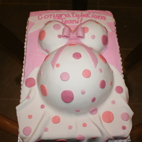 Belly Cake 9x13 sheet with ball pan and cupcakes. Iced in buttercream with fondant dress, polka dots, and banner
