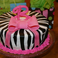 Zebra And Pink Bow buttercream with fondant zebra stripes. Gumpaste bow and letter B. Had a little crack in the B. Still getting the hang of fondant and...
