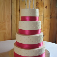 First Four Tier Buttercream Cake All buttercream with real ribbon.