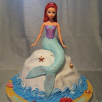 "Mermaid Cake mermaid is actually a doll with legs - her legs are stuck down into the ""rock"" cake (baked in the wondermold pan). I sculpted the..."