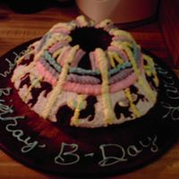 Caurosel Cake My daughter turned eight and I wanted to make her somthing special, So I made her this! And had alot of fun doing it.
