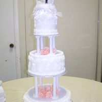 3 Tier White Wedding Cake This was my first attempt using pillars to stack the cakes.The bride wanted all 3 cakes to be white cake with fresh strawberry filling. The...