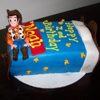 Cowboy Cake The 2 year old boy loves Woody and anything that has to do with cowboys.The cake is 1 layer chocolate, 1 layer vanilla and the bottom is...
