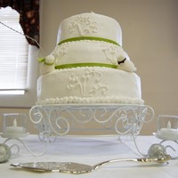 3 Tier Wedding Cake My daughter wanted a simple white cake with buttercream frosting and love birds on it. The love birds are fondant. Top layer is pistachio,...