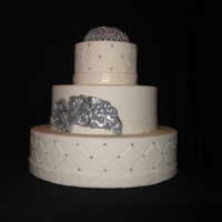 Broach Wedding Cake This is a white wedding cake with 2 hand made gumpaste broaches. The top broach is 4 inch in diameter and was dried over a bowl to give it...